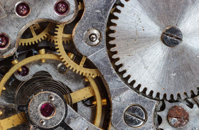 Many gears of a machine like inside a watch